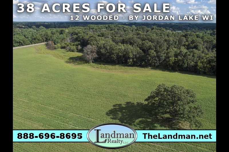 Wooded Farm Acreage for Sale by Jordan Lake WI